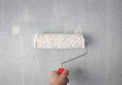 person-holding-paint-roller-on-wall-1669754 (1)
